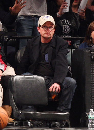 Mar 8, 2015; Brooklyn, NY, USA; Movie star Michael J. Fox during a time out during the fourth quarter of a game between the Brooklyn Nets and the Utah Jazz at Barclays Center. The Jazz defeated the Nets 95-88. Mandatory Credit: Brad Penner-USA TODAY Sports