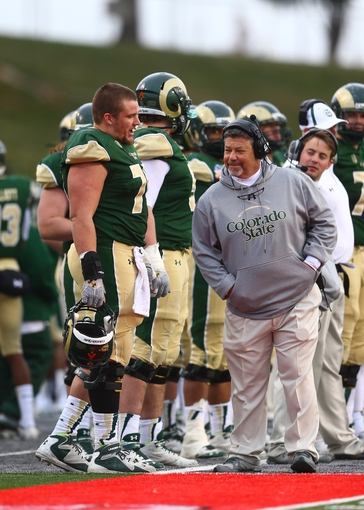 Dec 21, 2013; Albuquerque, NM, USA; Colorado State Rams offensive lineman Weston Richburg (70) talks to tight ends coach Art Valero against the Washington State Cougars during the Gildan New Mexico Bowl at University Stadium. Mandatory Credit: Mark J. Rebilas-USA TODAY Sports