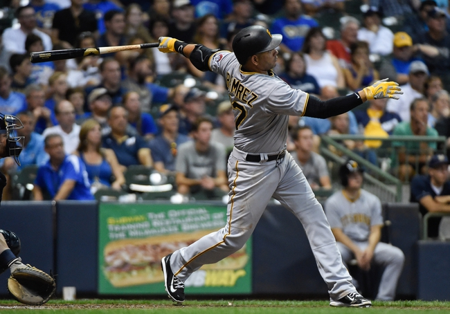 Sep 2, 2015; Milwaukee, WI, USA; Pittsburgh Pirates third baseman Aramis Ramirez (17) drives in a run with a double in the fifth inning against the Milwaukee Brewers at Miller Park. Mandatory Credit: Benny Sieu-USA TODAY Sports