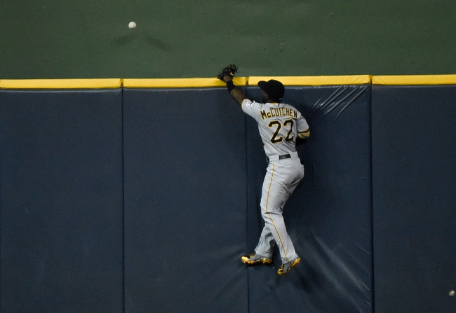 Sep 2, 2015; Milwaukee, WI, USA; Pittsburgh Pirates center fielder Andrew McCutchen (22) can't catch home run hit by Milwaukee Brewers first baseman Adam Lind (not pictured) in the fifth inning at Miller Park. Mandatory Credit: Benny Sieu-USA TODAY Sports