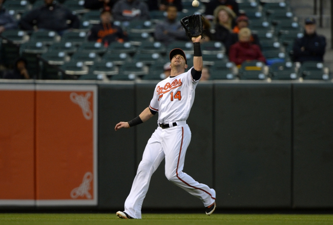 Apr 28, 2016; Baltimore, MD, USA;  Baltimore Orioles left fielder Nolan Reimold (14) catches a fly ball hit by Chicago White Sox right fielder Adam Eaton (not pictured) during the first inning against the Chicago White Sox at Oriole Park at Camden Yards. Mandatory Credit: Tommy Gilligan-USA TODAY Sports