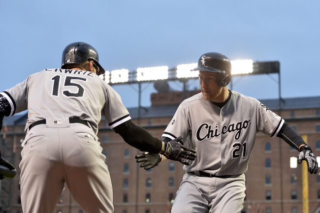 Apr 28, 2016; Baltimore, MD, USA; Chicago White Sox third baseman Todd Frazier (21) celebrates with  second baseman Brett Lawrie (15)  after hitting a two run home run during the first inning against the Baltimore Orioles at Oriole Park at Camden Yards. Mandatory Credit: Tommy Gilligan-USA TODAY Sports