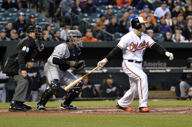 Apr 28, 2016; Baltimore, MD, USA;  Baltimore Orioles first baseman Chris Davis (19) singles during the first inning against the Chicago White Sox at Oriole Park at Camden Yards. Mandatory Credit: Tommy Gilligan-USA TODAY Sports
