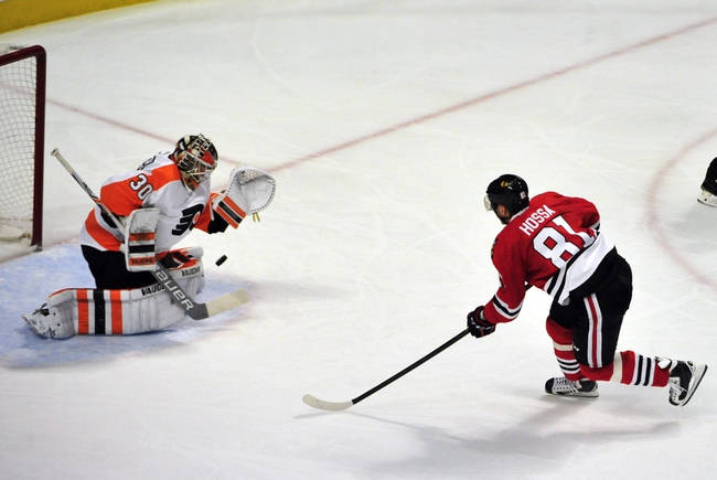 Hossa's 500th goal helps Blackhawks beat Flyers 7-4