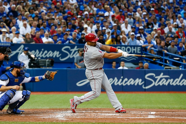 Martin has 3 hits, Blue Jays beat slumping Angels 7-2