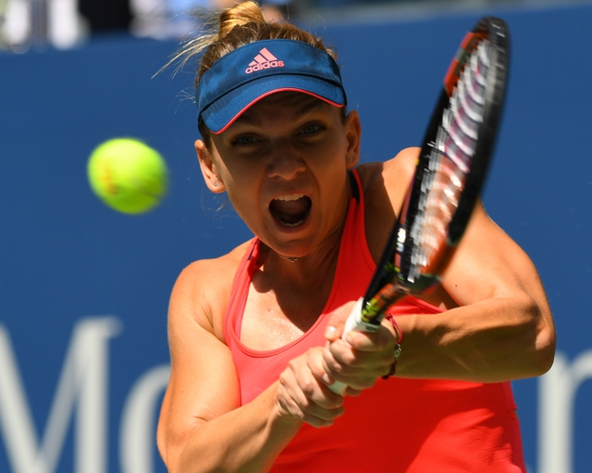 Halep through, Ivanovic knocked out