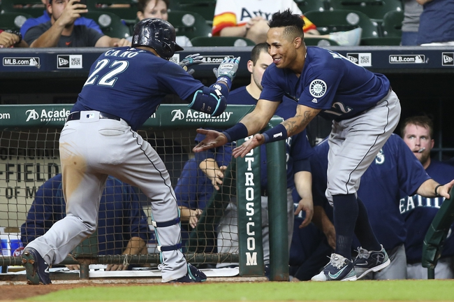 Cano homers as Mariners top Astros, boost playoff hopes
