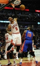 Mar 31, 2013; Chicago, IL, USA; Chicago Bulls power forward Carlos Boozer (5) dunks over Detroit Pistons center Greg Monroe (10) during the second half at the United Center. The Chicago Bulls defeated the Detroit Pistons 95-94. Mandatory Credit: David Banks-USA TODAY Sports