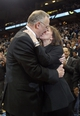 Apr 6, 2013; Minneapolis, MN, USA; Minnesota Timberwolves head coach Rick Adelman kisses his wife Mary Kay Adelman after getting his 100th career win as a head coach against the Detroit Pistons at Target Center. The Timberwolves won 107-101. Mandatory Credit: Jesse Johnson-USA TODAY Sports