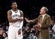 Apr 6, 2013; Brooklyn, NY, USA; Brooklyn Nets guard Joe Johnson (7) and head coach P.J. Carlesimo in the fourth quarter against Charlotte Bobcats at Barclays Center. Nets won 105-96. Mandatory Credit: Nicole Sweet-USA TODAY Sports