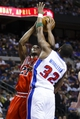 April 7, 2013; Auburn Hills, MI, USA; Chicago Bulls small forward Jimmy Butler (21) tries to shoot on Detroit Pistons small forward Khris Middleton (32) in the first quarter at The Palace. Mandatory Credit: Rick Osentoski-USA TODAY Sports