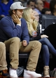 April 7, 2013; Auburn Hills, MI, USA; Detroit Lions quarterback Matthew Stafford (left) and girlfriend Kelly Hall laugh during the game between the Detroit Pistons and the Chicago Bulls at The Palace. Mandatory Credit: Rick Osentoski-USA TODAY Sports