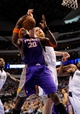 Apr 10, 2013; Dallas, TX, USA; Dallas Mavericks center Chris Kaman (35) and Phoenix Suns center Jermaine O'Neal (20) fight for the ball during the second half at the American Airlines Center. The Suns defeated the Mavericks 102-91. Mandatory Credit: Jerome Miron-USA TODAY Sports