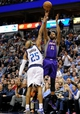Apr 10, 2013; Dallas, TX, USA; Phoenix Suns power forward Markieff Morris (11) shoots over Dallas Mavericks shooting guard Vince Carter (25) during the second half at the American Airlines Center. The Suns defeated the Mavericks 102-91. Mandatory Credit: Jerome Miron-USA TODAY Sports