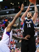 April 10, 2013; Los Angeles, CA, USA; Minnesota Timberwolves center Nikola Pekovic (14) shoots a basket against the defense of Los Angeles Clippers center DeAndre Jordan (6) during the first half at Staples Center. Mandatory Credit: Gary A. Vasquez-USA TODAY Sports
