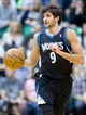Apr 12, 2013; Salt Lake City, UT, USA; Minnesota Timberwolves point guard Ricky Rubio (9) dribbles up court during the first half against the Utah Jazz at EnergySolutions Arena. Mandatory Credit: Russ Isabella-USA TODAY Sports