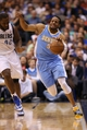 April 12, 2013; Dallas, TX, USA; Denver Nuggets guard Andre Iguodala (9) fights for a loose ball against Dallas Mavericks forward Elton Brand (42) at the American Airlines Center. The Mavs beat the Nuggets 108-105 in overtime. Mandatory Credit: Matthew Emmons-USA TODAY Sports