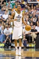 Apr 12, 2013; Salt Lake City, UT, USA; Utah Jazz point guard Alec Burks (10) dribbles up court during the second half against the Minnesota Timberwolves at EnergySolutions Arena. The Jazz won 107-100. Mandatory Credit: Russ Isabella-USA TODAY Sports