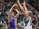Apr 13, 2013; Minneapolis, MN, USA; Phoenix Suns point guard Goran Dragic (1) shoots as Minnesota Timberwolves center Greg Stiemsma (34) defends during the second quarter at the Target Center. Mandatory Credit:  Greg Smith-USA TODAY Sports