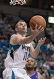 Apr 13, 2013; Minneapolis, MN, USA; Minnesota Timberwolves point guard J.J. Barea (11) shoots against the Phoenix Suns in the fourth quarter at the Target Center. Timberwolves won 105-93. Mandatory Credit:  Greg Smith-USA TODAY Sports