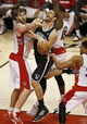 Apr 14, 2013; Toronto, ON, Canada; Brooklyn Nets center Brook Lopez (11) is fouled by Toronto Raptors center Aaron Gray (34) at the Air Canada Centre. The Raptors beat the Nets 93-87. Mandatory Credit: Tom Szczerbowski-USA TODAY Sports