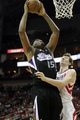 April 14, 2013; Houston, TX, USA; Sacramento Kings center DeMarcus Cousins (15) takes a shot against the Houston Rockets in the third quarter at the Toyota Center. The Rockets defeated the Kings 121-100. Mandatory Credit: Brett Davis-USA TODAY Sports