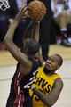 Apr 15, 2013; Cleveland, OH, USA; Cleveland Cavaliers power forward Marreese Speights (15) defends a shot by Miami Heat power forward Jarvis Varnado (24) in the second quarter at Quicken Loans Arena. Mandatory Credit: David Richard-USA TODAY Sports