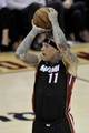 Apr 15, 2013; Cleveland, OH, USA; Miami Heat power forward Chris Andersen (11) makes a three-point basket at the end of the first quarter against the Cleveland Cavaliers at Quicken Loans Arena. Mandatory Credit: David Richard-USA TODAY Sports