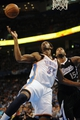 Apr 15, 2013; Oklahoma City, OK, USA; Oklahoma City Thunder center Hasheem Thabeet (34) fights for a rebound with Sacramento Kings center DeMarcus Cousins (15) during the first half at Chesapeake Energy Arena. Mandatory Credit: Mark D. Smith-USA TODAY Sports