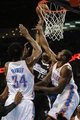 Apr 15, 2013; Oklahoma City, OK, USA; Sacramento Kings center DeMarcus Cousins (15) attempts a shot against Oklahoma City Thunder forward Serge Ibaka (9) and Thunder center Hasheem Thabeet (34) during the first half at Chesapeake Energy Arena. Mandatory Credit: Mark D. Smith-USA TODAY Sports