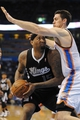Apr 15, 2013; Oklahoma City, OK, USA; Sacramento Kings center DeMarcus Cousins (15) handles the ball against Oklahoma City Thunder forward Nick Collison (4) during the first half at Chesapeake Energy Arena. Mandatory Credit: Mark D. Smith-USA TODAY Sports