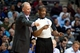 April 15, 2013; Auburn Hills, MI, USA; Philadelphia 76ers head coach Doug Collins talks to referee Tony Brown (6) during the fourth quarter against the Detroit Pistons at The Palace. Detroit won 109-101. Mandatory Credit: Tim Fuller-USA TODAY Sports