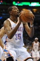 Apr 15, 2013; Oklahoma City, OK, USA; Oklahoma City Thunder forward Kevin Durant (35) attempts a shot against the Sacramento Kings during the first half at Chesapeake Energy Arena. Mandatory Credit: Mark D. Smith-USA TODAY Sports