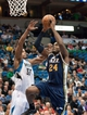 Apr 15, 2013; Minneapolis, MN, USA; Utah Jazz power forward Paul Millsap (24) drives to the basket and Minnesota Timberwolves power forward Dante Cunningham (33) defends in the fourth quarter at Target Center. The Jazz won 96-80. Mandatory Credit:  Greg Smith-USA TODAY Sports