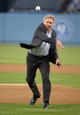 Apr 15, 2013; Los Angeles, CA, USA; Film actor Harrison Ford throws out the first pitch before the MLB game between the San Diego Padres and the Los Angeles Dodgers at Dodger Stadium. Mandatory Credit: Kirby Lee-USA TODAY Sports