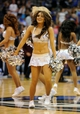 Apr 15, 2013; Dallas, TX, USA; A Dallas Mavericks dancer performs during a time out in the the second half of the game between the Mavericks and the Memphis Grizzlies at the American Airlines Center. The Grizzlies defeated the Mavericks 103-97. Mandatory Credit: Jerome Miron-USA TODAY Sports