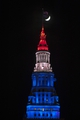 Apr 15, 2013; Cleveland, OH, USA; The moon is seen behind the Terminal Tower in Cleveland which was lit red, white and blue during a game between the Cleveland Cavaliers and the Miami Heat at Quicken Loans Arena to show support after the explosions at the Boston Marathon earlier in the day. Mandatory Credit: David Richard-USA TODAY Sports