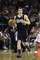 April 14, 2013; Houston, TX, USA; Sacramento Kings point guard Jimmer Fredette (7) dribbles the ball against the Houston Rockets in the fourth quarter at the Toyota Center. The Rockets defeated the Kings 121-100. Mandatory Credit: Brett Davis-USA TODAY Sports
