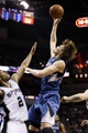 Apr 17, 2013; San Antonio, TX, USA; Minnesota Timberwolves  forward Andrei Kirilenko (47) puts up a shot over San Antonio Spurs forward Kawhi Leonard (2) during the second half at the AT&T Center. The Timberwolves won 108-95.  Mandatory Credit: Soobum Im-USA TODAY Sports
