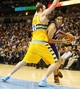 April 17, 2013; Denver, CO, USA; Phoenix Suns forward Luis Scola (14)  drives to the basket past Denver Nuggets center Kosta Koufos (41) during the second half at the Pepsi Center.  The Nuggets won 118-98.  Mandatory Credit: Chris Humphreys-USA TODAY Sports