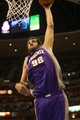 April 17, 2013; Denver, CO, USA; Phoenix Suns center Hamed Haddadi (98) dunks the ball during the second half against the Denver Nuggets at the Pepsi Center.  The Nuggets won 118-98.  Mandatory Credit: Chris Humphreys-USA TODAY Sports