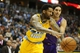 April 17, 2013; Denver, CO, USA; Phoenix Suns forward Luis Scola (right) battles Denver Nuggets forward Wilson Chandler (left) for a loose ball during the second half at the Pepsi Center.  The Nuggets won 118-98.  Mandatory Credit: Chris Humphreys-USA TODAY Sports