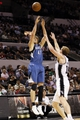 Apr 17, 2013; San Antonio, TX, USA; Minnesota Timberwolves  forward Andrei Kirilenko (47) shoots over San Antonio Spurs forward Matt Bonner (right) during the second half at the AT&T Center. The Timberwolves won 108-95.  Mandatory Credit: Soobum Im-USA TODAY Sports