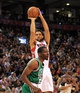 Apr 17, 2013; Toronto, Ontario, CAN; Toronto Raptors small forward Landry Fields (2) shoots over the top of Boston Celtics shooting guard Jordan Crawford (27) during the fourth quarter at the Air Canada Centre. The Raptors beat the Celtics 114-90. Mandatory Credit: Kevin Hoffman-USA TODAY Sports