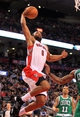 Apr 17, 2013; Toronto, Ontario, CAN; Toronto Raptors shooting guard Alan Anderson (6) goes up to dunk the ball against the Boston Celtics during the fourth quarter at the Air Canada Centre. The Raptors beat the Celtics 114-90. Mandatory Credit: Kevin Hoffman-USA TODAY Sports