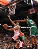 Apr 17, 2013; Toronto, Ontario, CAN; Toronto Raptors point guard Kyle Lowry (3) goes up for a lay up as Boston Celtics power forward D.J. White (12) defends during the third quarter at the Air Canada Centre. The Raptors beat the Celtics 114-90. Mandatory Credit: Kevin Hoffman-USA TODAY Sports