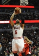 Apr 17, 2013; Chicago, IL, USA; Chicago Bulls power forward Carlos Boozer (5) shoots over a Washington Wizard defender during the second half at the United Center. The Chicago Bulls defeated the Washington Wizards 95-92. Mandatory Credit: David Banks-USA TODAY Sports