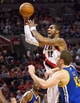 April 17, 2013; Portland, OR, USA; Portland Trail Blazers power forward LaMarcus Aldridge (12) shoots over Golden State Warriors power forward David Lee (10) in the first half at the Rose Garden.  Mandatory Credit: Jaime Valdez-USA TODAY Sports