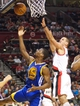April 17, 2013; Portland, OR, USA; Golden State Warriors point guard Stephen Curry (30) and Portland Trail Blazers shooting guard Sasha Pavlovic (3) reach for rebound in the first half at the Rose Garden.  Mandatory Credit: Jaime Valdez-USA TODAY Sports
