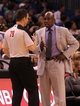 Apr 13, 2013; Orlando, FL, USA; Orlando Magic head coach Jacque Vaughn talks with the referee against the Boston Celtics during the second half at the Amway Center. Boston Celtics defeated the Orlando Magic 120-88. Mandatory Credit: Kim Klement-USA TODAY Sports